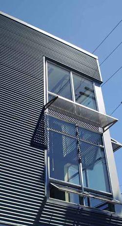 perforated metal window shades by Hendrick