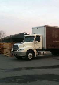 j gibson mcilvain truck with stacked wood