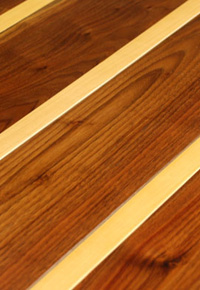 Rehmeyer Extreme Custom Floors: Pin –Striped Walnut with Hard Maple Feature Strip