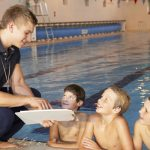 swim instructor talking with students