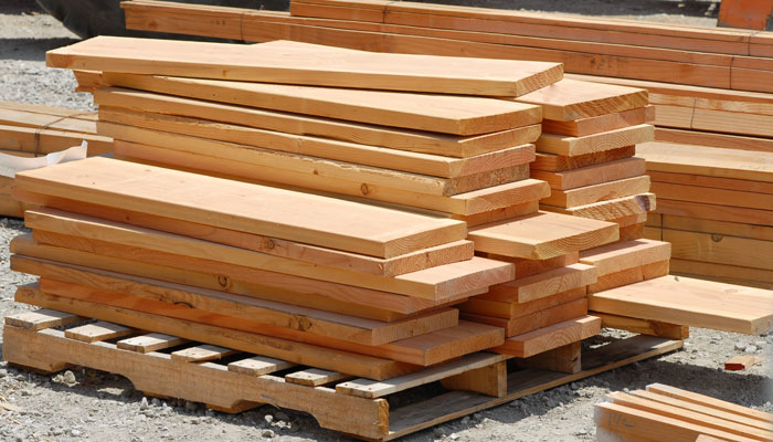 freshly cut wooden boards stacked at lumber mill
