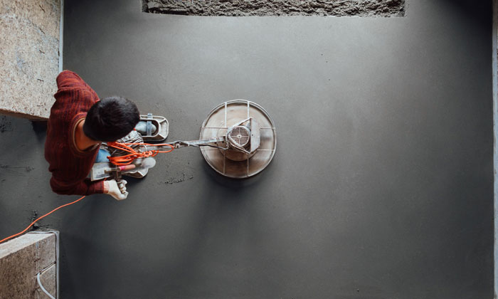 smoothing fresh concrete with machine