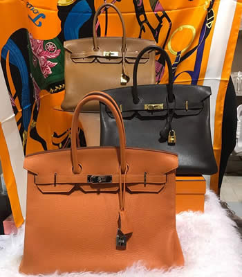 hermes birkins in gold brown orange