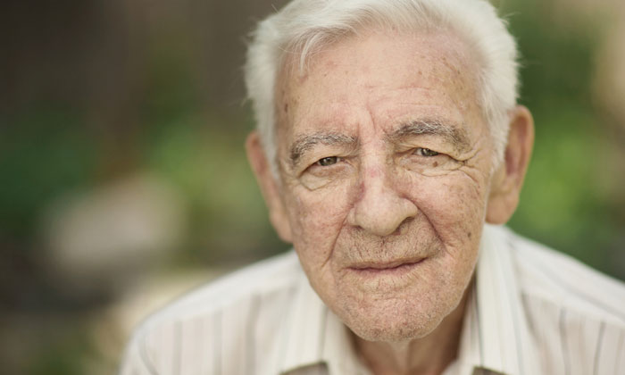elderly man looking into camera