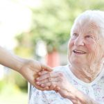 friendly hand out to hold elderly ladys hand