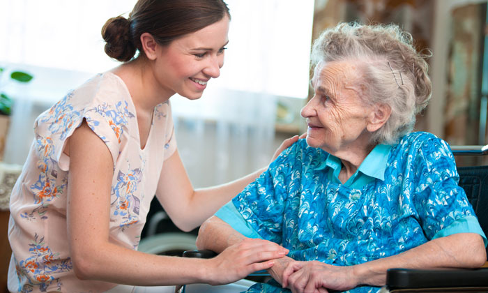 young home care helper woman assisting elderly lady