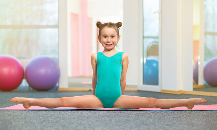 young girl doing leg gymnastic stretches