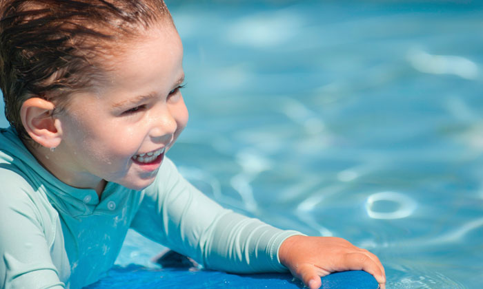 happiness is swimming in the pool for child