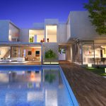 contemporary house with clear walls pool beside