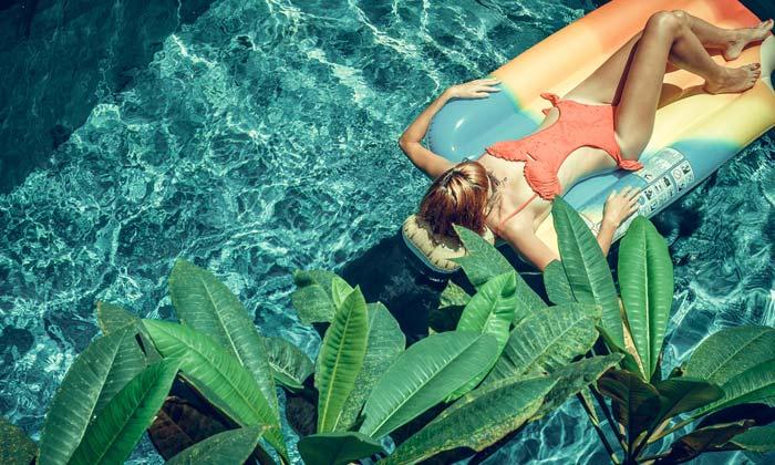 green plants beside swimming pool