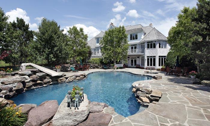 backyard estate swimming pool with slide